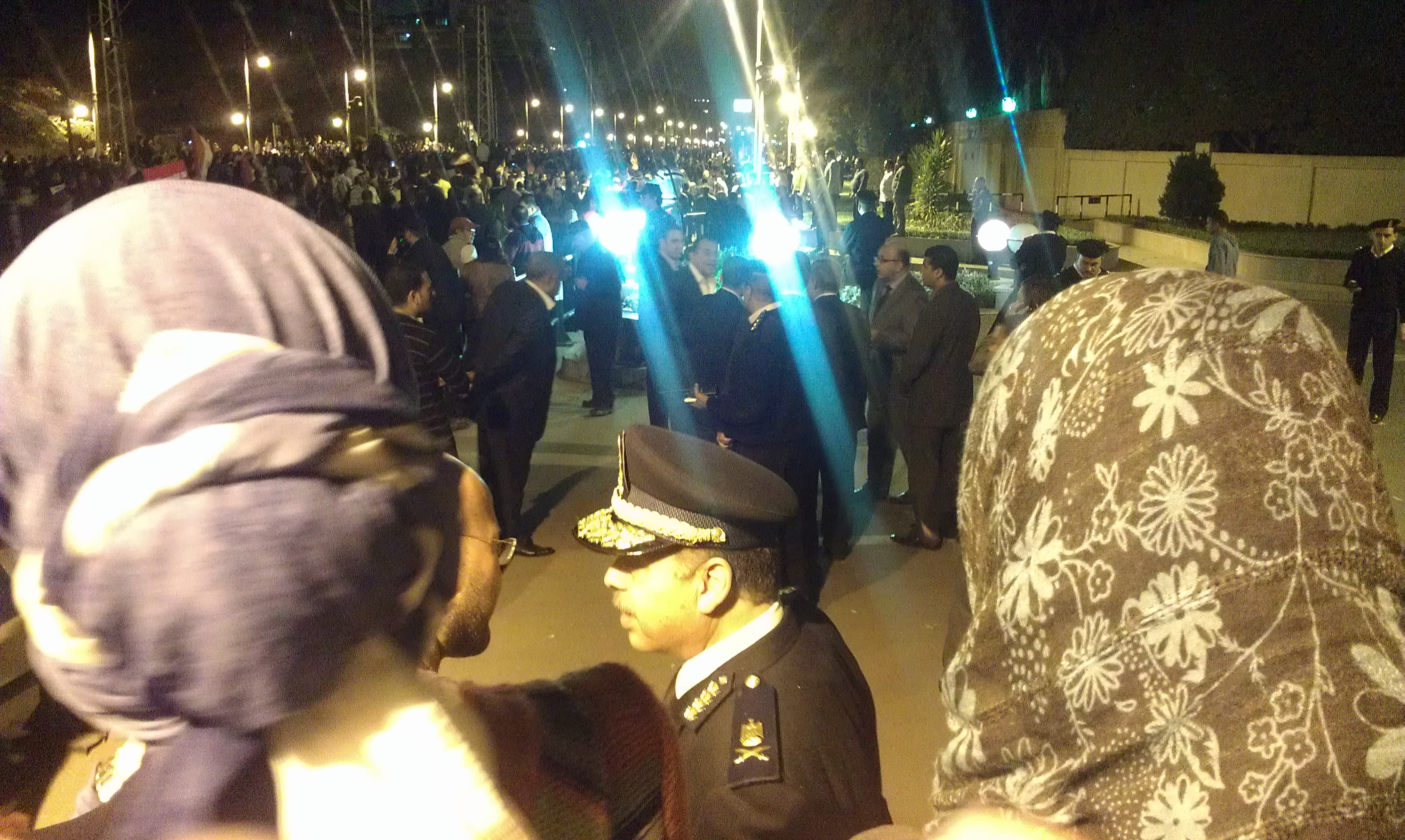 Police Officer talking to protesters.