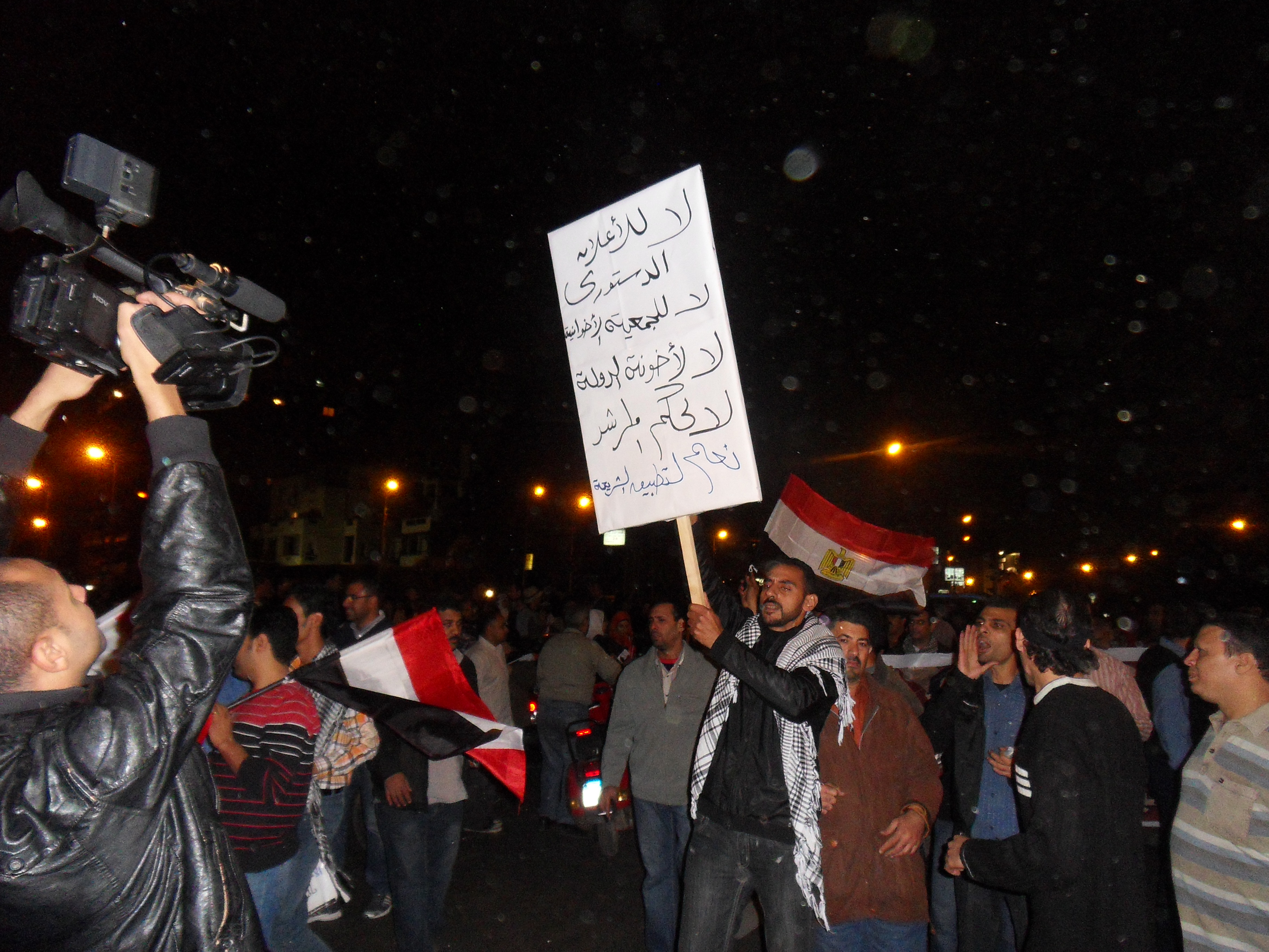 A new group of protesters had arrived. The existing protesters broke out in cheers and clapped upon their arrival.