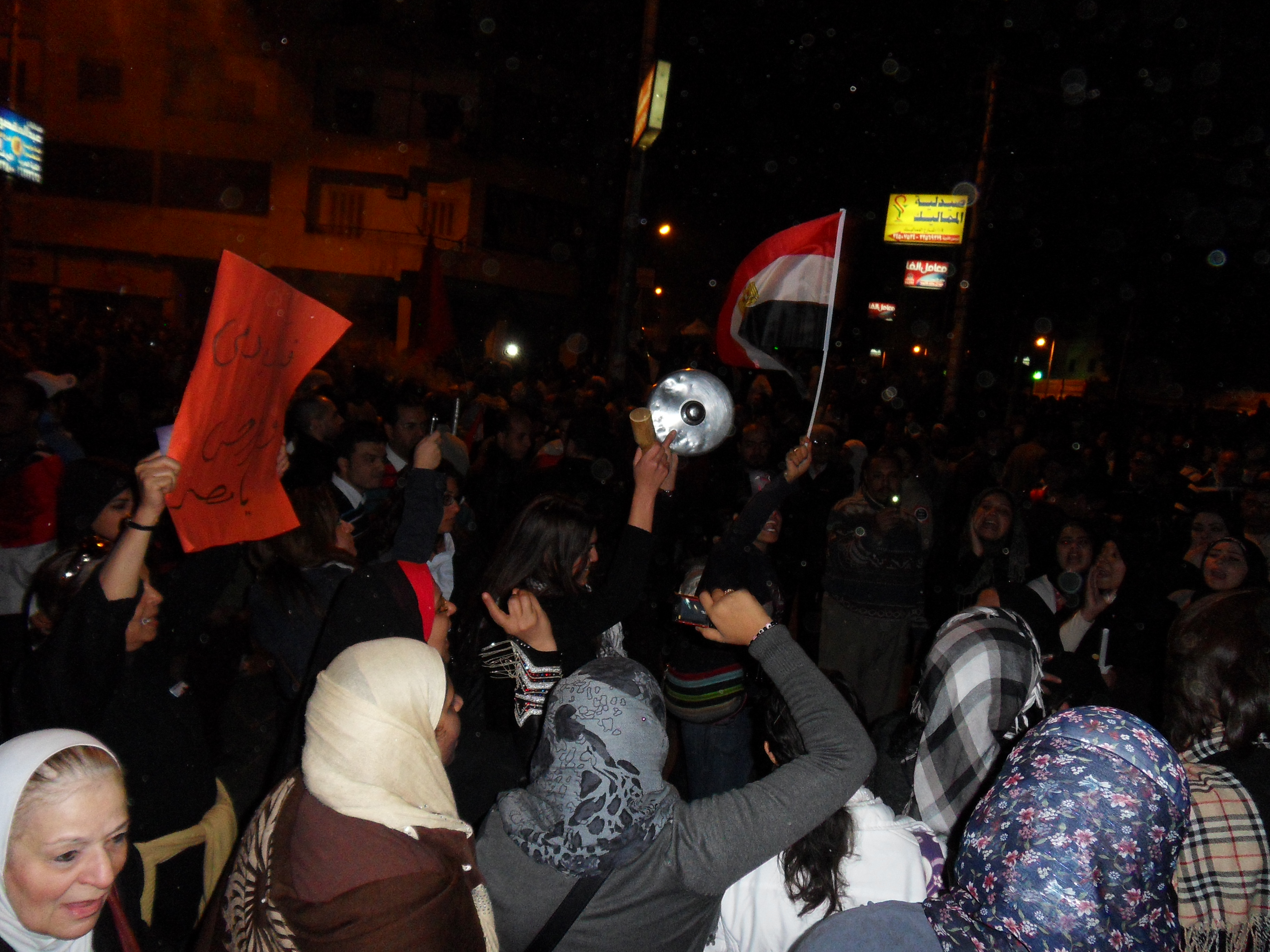Women singing songs and chanting against Morsi.