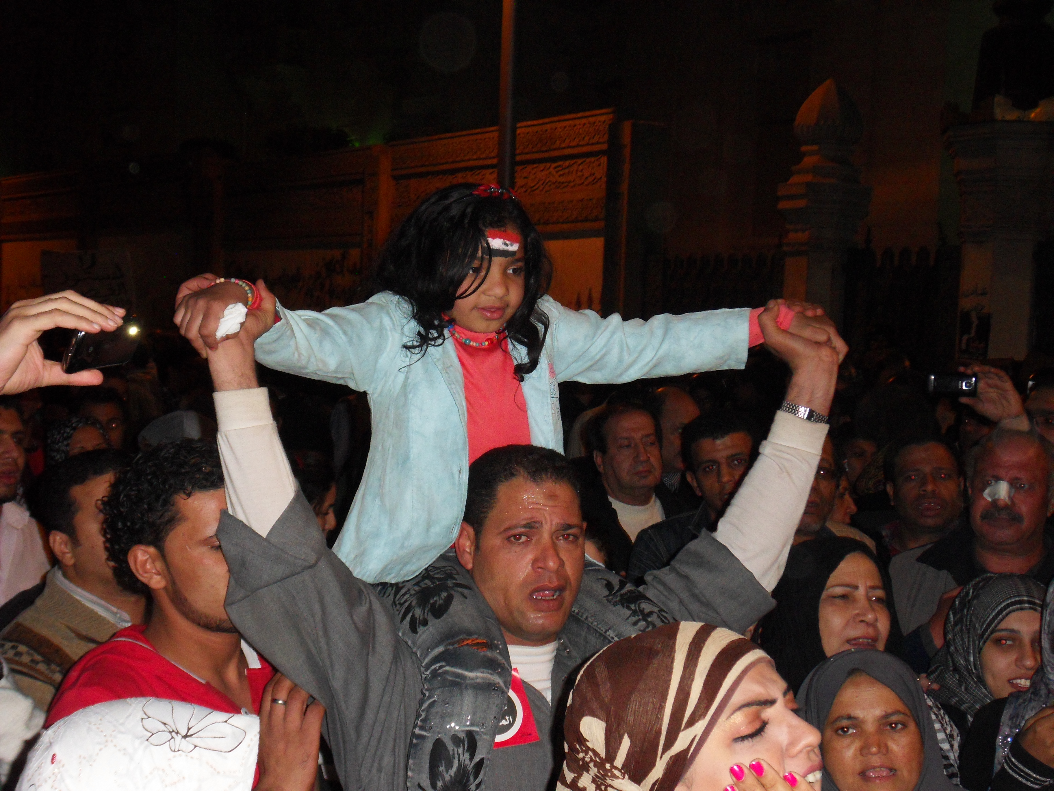 One of the few children I saw tonight. She was leading the crowd's chants.