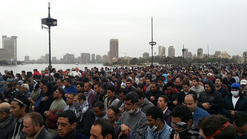 Protesters praying on Qasr Al Nil Bridge (near Tahrir Square) to mark January 28