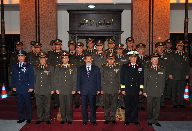 Egypt's President Morsi surrounded by top military officials following a meeting last night.