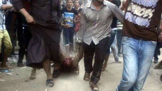 One of the victims being dragged in the streets