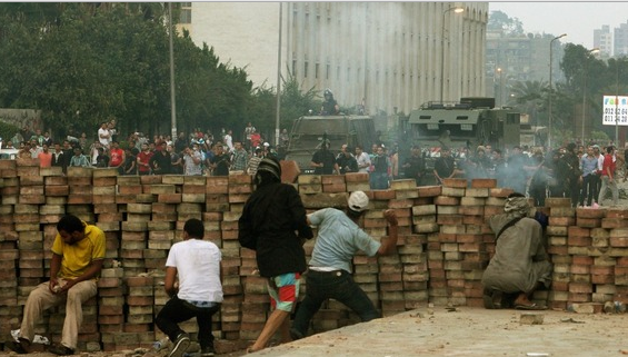 Clashes between police and Morsi supporters continued Sunday morning.