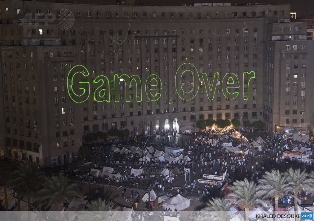 Protesters in Tahrir Square use lasers to demanding President Morsi's resignation