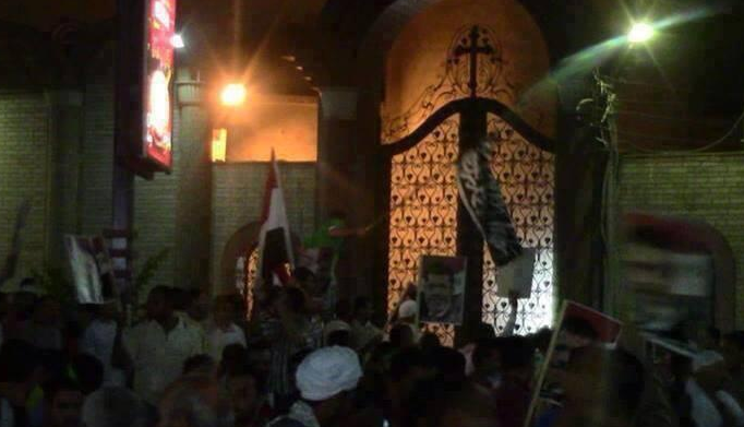 "Yesterday in Sohag, Islamists barricaded the entrance of a church and hung black ""Al-Qaeda"" flags on its gate."