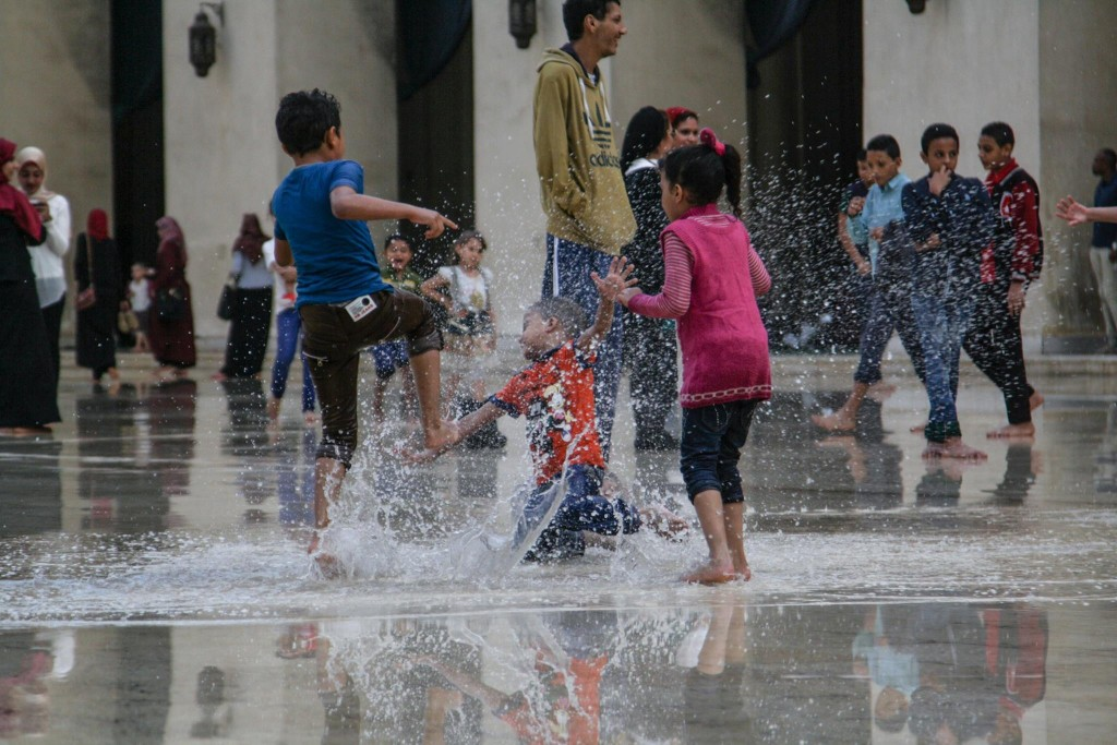 Kids playing with rainwater inside a mosque in Cairo. Credit: Enas El Masry