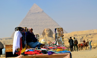A vendor at the Pyramids with no tourists in sight