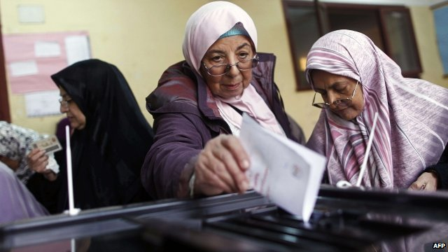 Women line up to cast their vote in 2012.