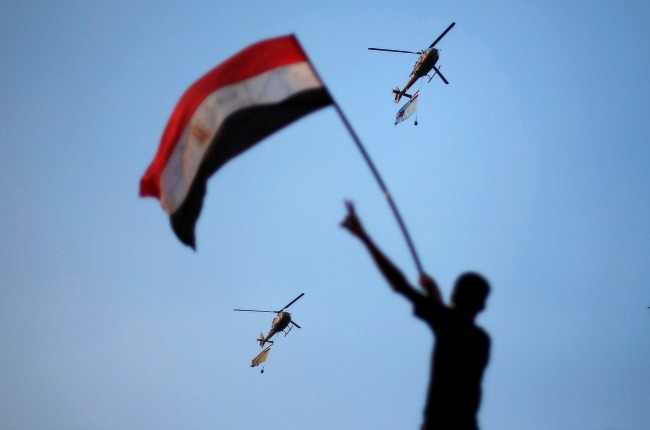 Military helicopters circle over Tahrir Square on July 1, 2013. (Credit: Suhaib Salem from Reuters)