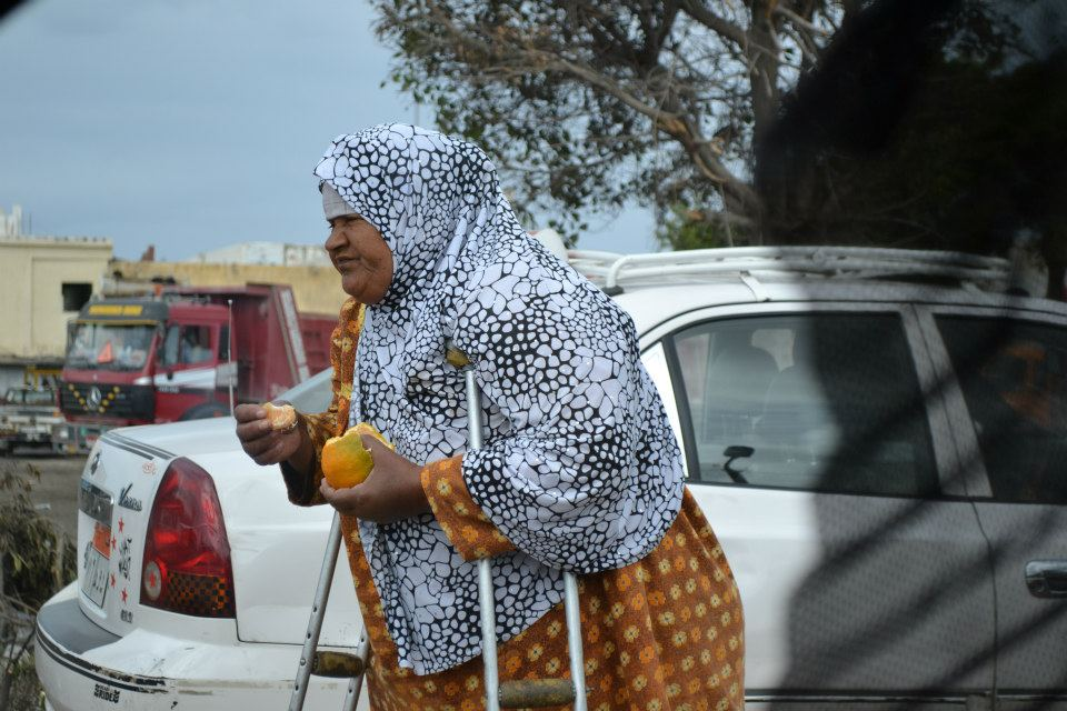 In the middle of flooded Alexandrian streets, this woman was returning to her orange stall