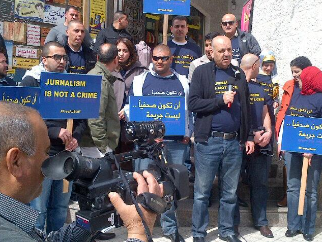 Dozens gathered in Ramallah to show their support for detained journalists.