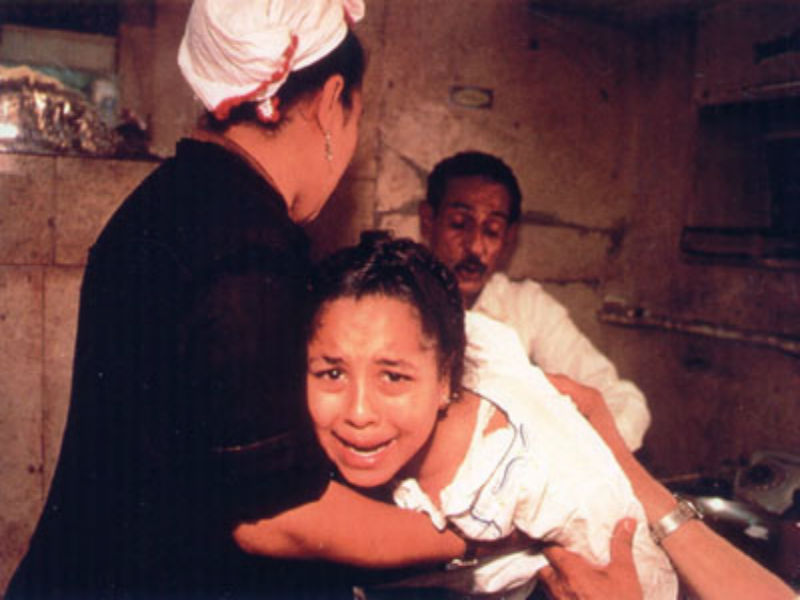 Famous photograph taken by a CNN reporter in the 1990s of female genital mutilation being performed in Egypt.