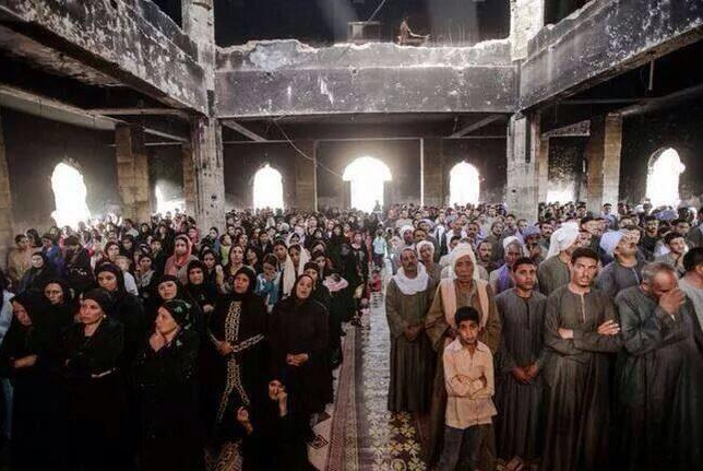 Coptic Christians pray in a church which was torched shortly after the ouster of Islamist President Mohammed Morsi