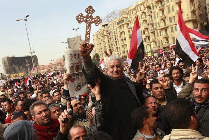 Coptic Christians join with Muslim protesters in a show of unity in Tahrir Square in Cairo, Egypt, Sunday, February 6, 2011. (Carolyn Cole/Los Angeles Times/MCT)