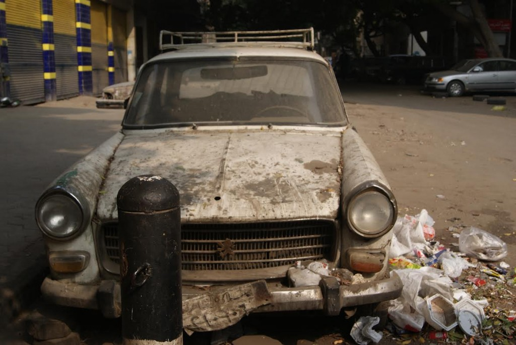 An abandoned white Peugeot on Mohamed Helmet Ibrahim Street