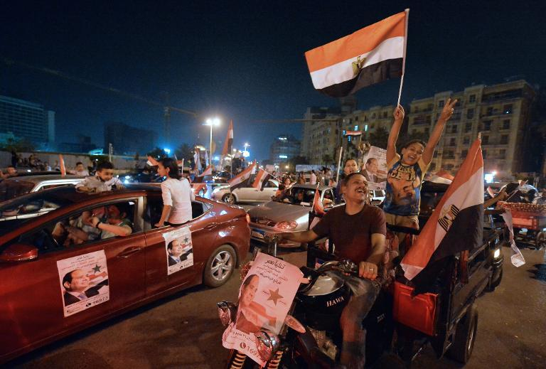 Supporters of Sisi celebrate at Tahrir Square after initial results on May 28, 2014. Credit: AFP