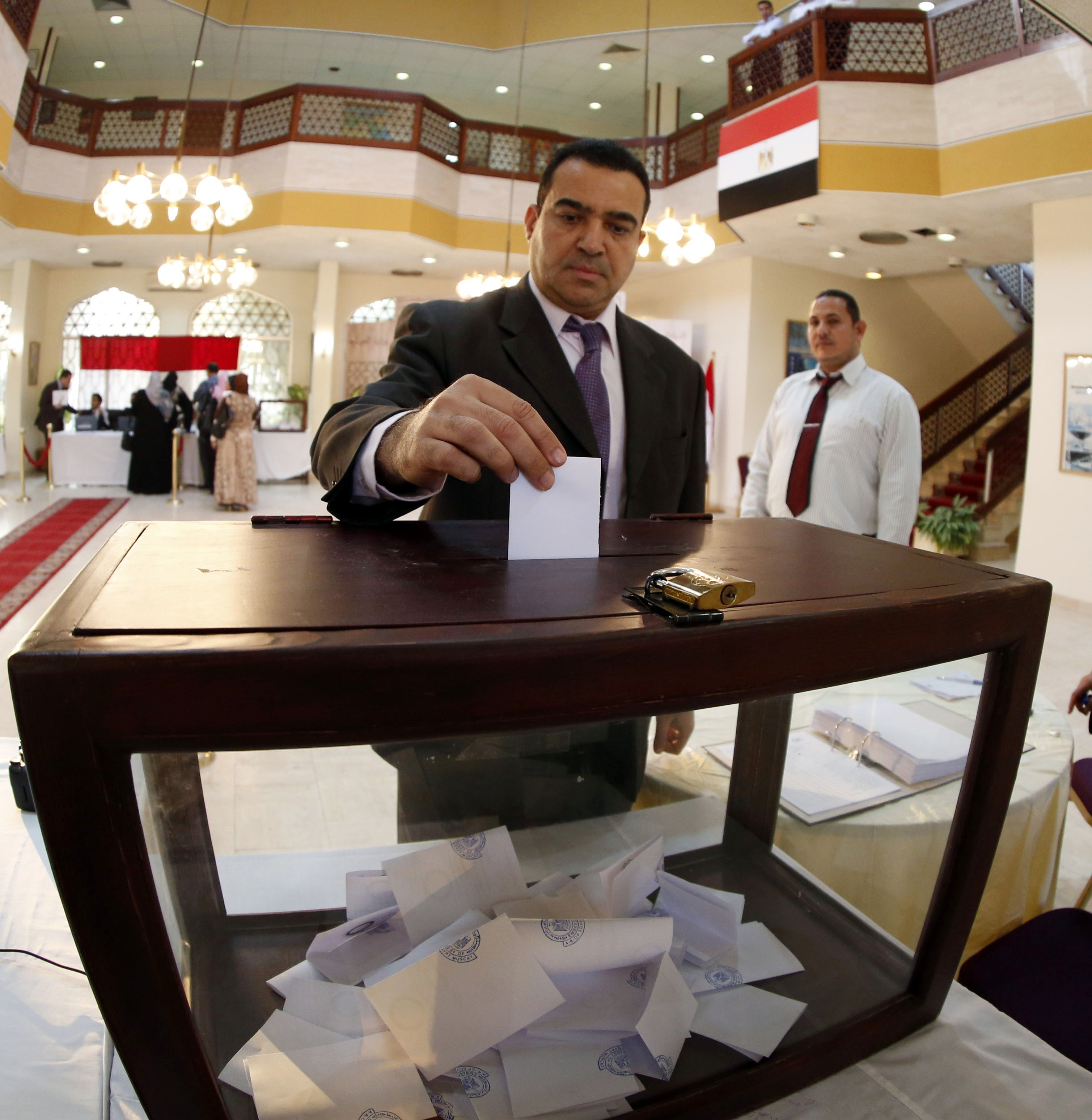 An Egyptian living in Oman casts his vote in January 2014 on Egypt's constitution.