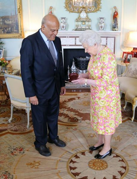 The Queen delivering the Order of the Merit to Professor Sir Magdi Yacoub.