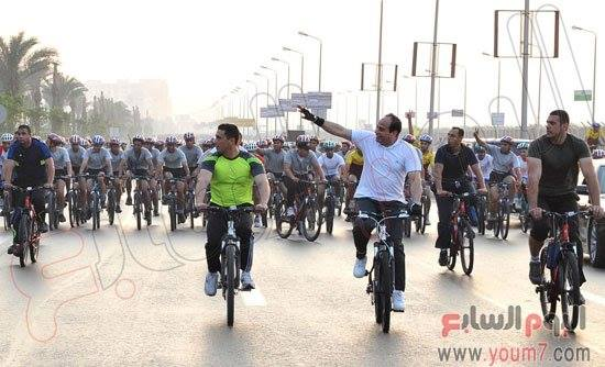 President Abdel Fattah Al-Sisi taking part in a cycling marathon earlier today.