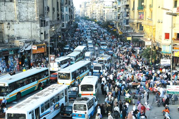 overcrowded area causing pedestrians to share roads with vehicles.