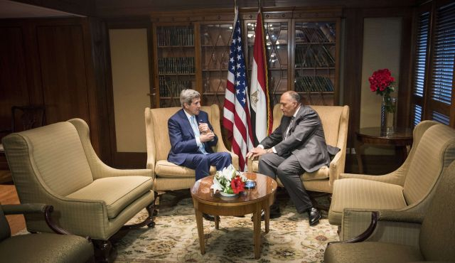U.S. Secretary of State John Kerry meets with Egyptian Foreign Minister Sameh Shoukri upon his arrival in the capital Cairo June 22, 2014. Photo by AFP