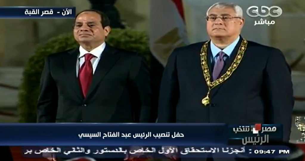 President Abdel Fattah Al-Sisi honors Former Interim President Adly Mansour with the Order of the Nile.
