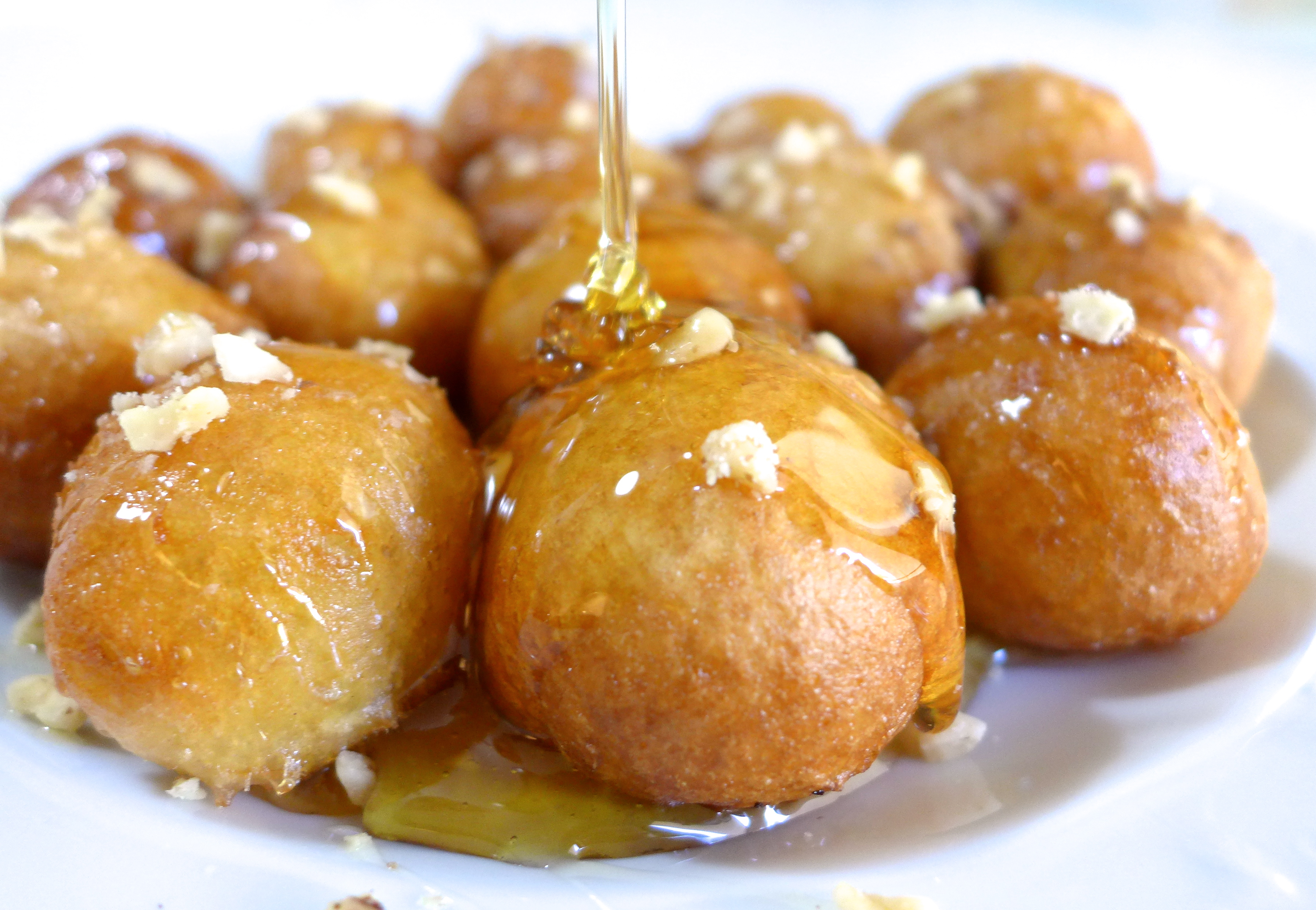 19 middle eastern desserts to remember this ramadan egyptian streets loukoumades drizzled with honey forumfinder Images