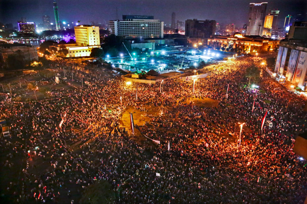 In this Sunday, June 8, 2014 photo, supporters of Egyptian President Abdel-Fattah el-Sissi celebrate his inauguration in Tahrir Square, Cairo, Egypt. (AP Photo/Thomas Hartwell)