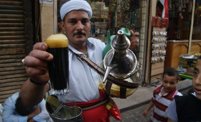 A man selling juice in El Hussein.