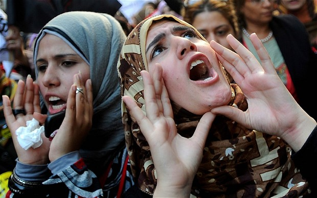 Women protest against violence. Photo: EPA/MOHAMED