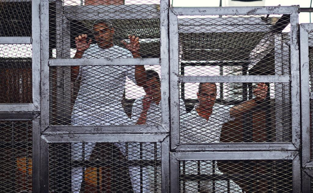 Detained Al-Jazeera journalists appear in court in June before being sentenced to prison Credit: Amir Makar