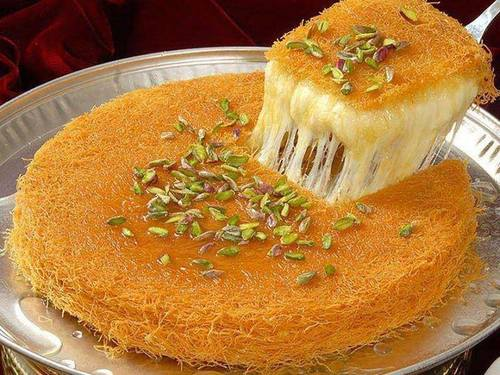 Middle Eastern Kunafeh topped with pistachios.