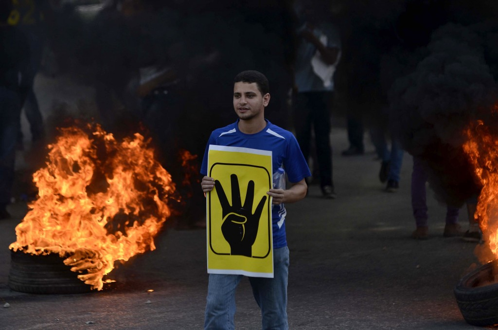 An Egyptian protester on August 2013 following the dispersal of thousands of Muslim Brotherhood and Morsi supporters. Credit: AFP