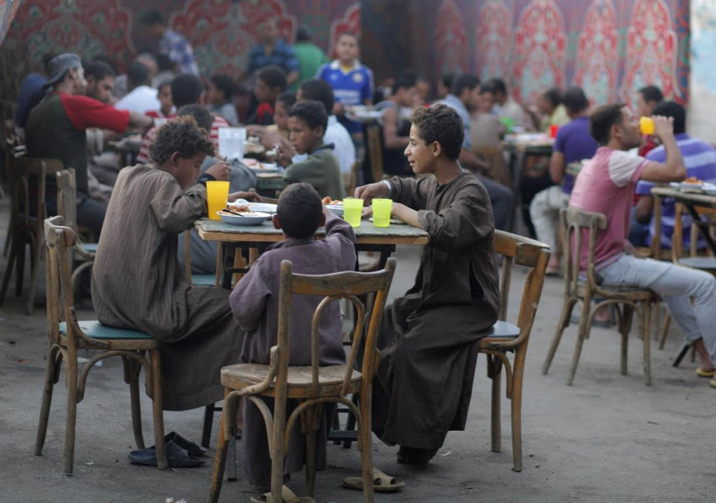 Egyptians  break their fast during a holy month of Ramadan  in Cairo, Egypt, Tuesday, July 24, 2012.  (AP Photo/Amr Nabil)