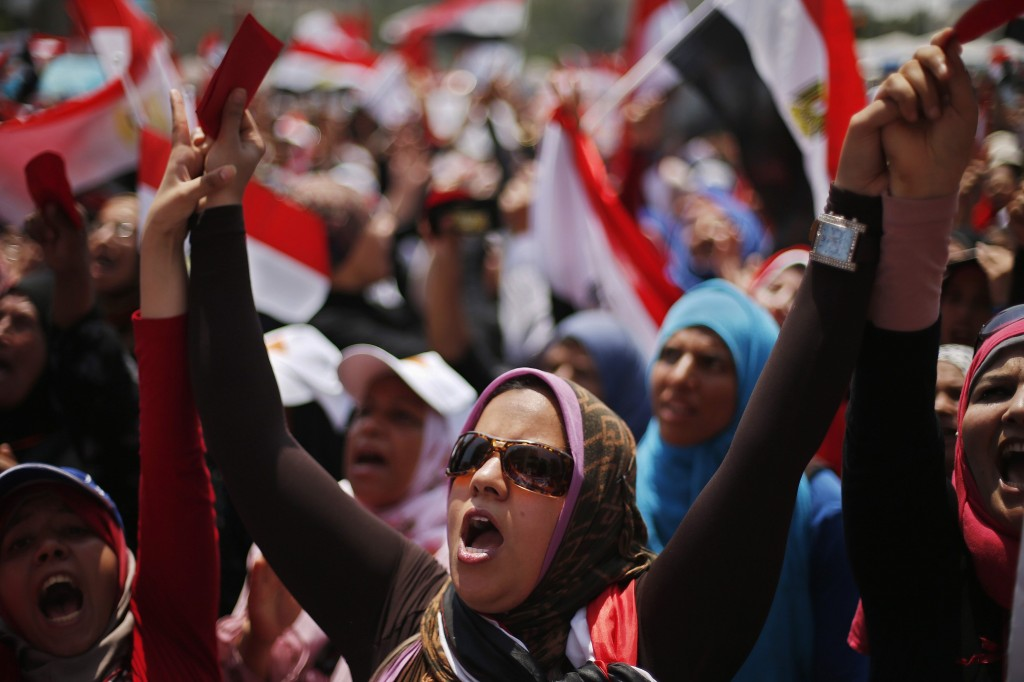 Protesters opposing Egyptian President Mursi take part in protest demanding that he resign at Tahrir Square in Cairo
