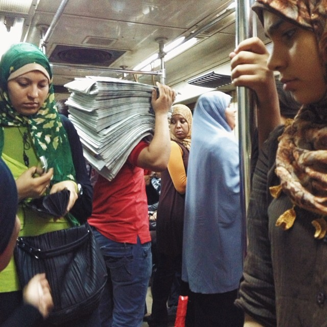 Photo by Christina Rizk Today's news is old news. On my way home after a long day covering protests around Cairo a man was selling newspapers on the women's metro car.