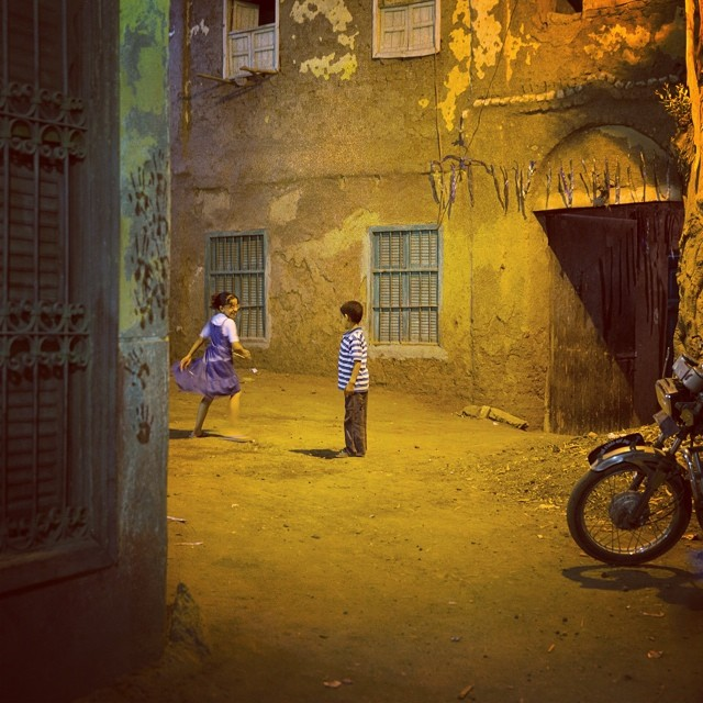 Photo by Tinne Van Loon While attending a friend's wedding in Koum el Atroun, a remote village two hours outside of Cairo, I saw this scene in the side street. These children were playing together under the light of a street lamp and it was just such a simple reminder of how innocent and beautiful childhood can be in all its simplicity. This is a universal moment that anyone can connect with, no matter where they're from. A nice detail that is more Egypt-specific is the bloodied hand prints from Eid on the wall on the left, which actually look quite child-like as well.