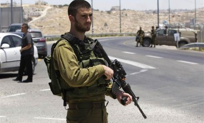 An Israeli soldier standing at the West Bank city of Hebron. Photo: Reuters