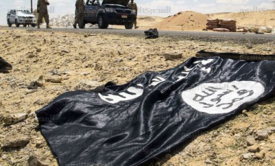 A black Al-Qaeda flag found at the scene of the attack. Credit: AMAY