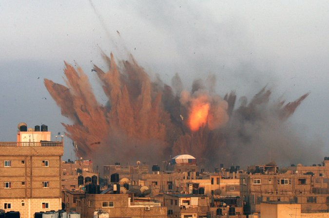 An Israeli air strike caused an explosion Friday in Rafah, in the southern Gaza Strip. Credit Said Khatib/Agence France-Presse — Getty Images