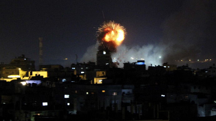 Smoke and flames are seen following what witnesses said was an Israeli air strike in Rafah, in the southern Gaza Strip July 11, 2014. (Reuters/Abed Sha'at)