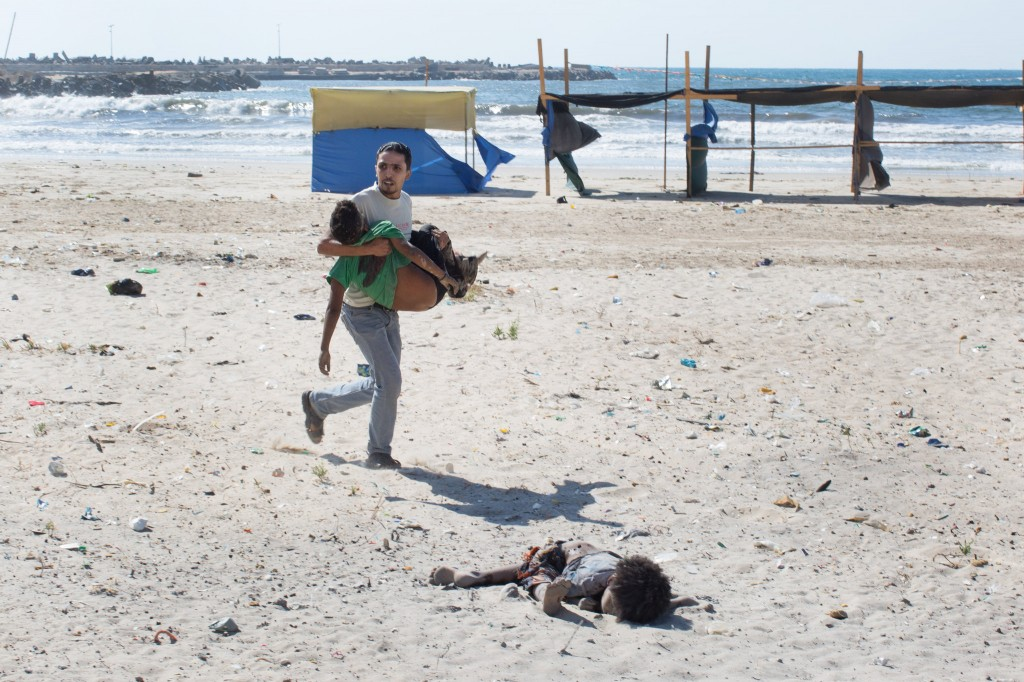 The aftermath of an air-strike on a beach in Gaza City on Wednesday. Four young Palestinian boys, all cousins, were killed. Credit Tyler Hicks/The New York Times