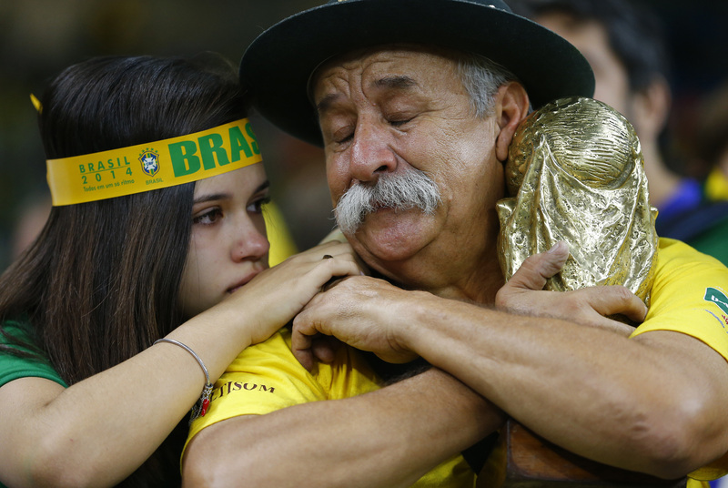Fans react to Brazil's loss. Credit: REUTERS/Damir Sagolj