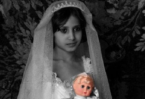 A child bride holding her doll.