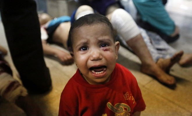 A Palestinian child, wounded in an Israeli strike on a compound housing a U.N. school in Beit Hanoun, in the northern Gaza Strip, cries at the emergency room of the Kamal Adwan hospital in Beit Lahiya, Thursday, July 24, 2014. Credit: LEFTERIS PITARAKIS/ASSOCIATED PRESS
