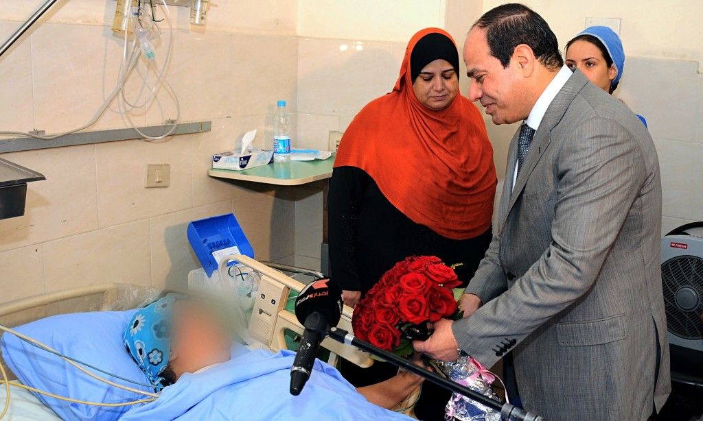 Egypt's President Sisi visits a sexual assault victim in hospital in June 2014.