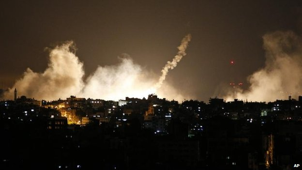 Smoke rises from flares in Gaza as Israel announces a ground offensive. Credit: AP