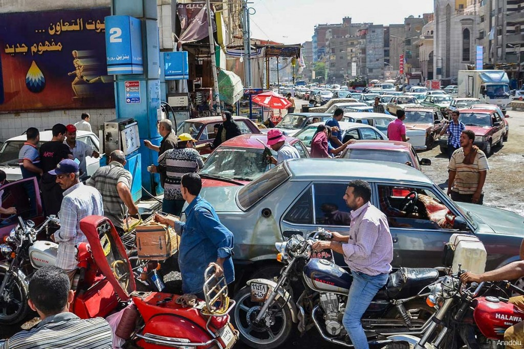 Egyptians often face long queues at petrol stations due to a shortage in supply.