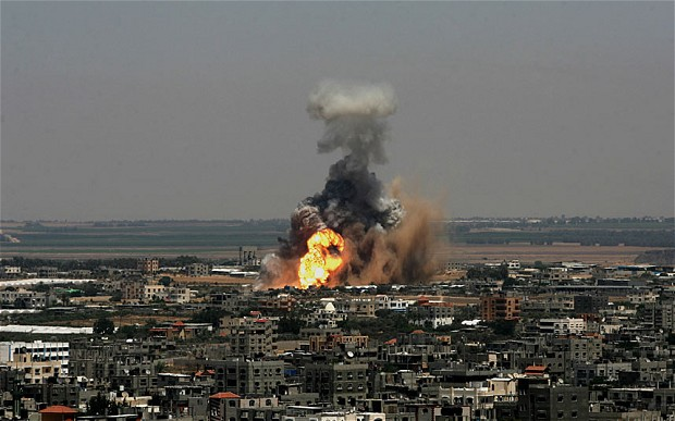 Smoke and flames are seen following an alleged air strike which bombarded dozens of targets in the Gaza Strip, Israel on Tuesday Photo: Corbis